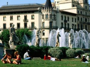 People Relaxing in Plaza de Catalunya, Barcelona, Catalonia, Spain by John Elk III