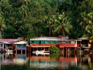 Stilt Houses, Chamorro Bay, Colonia, Micronesia by John Elk III
