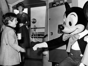 John F Kennedy Jr Shake Hands with Mickey Mouse During Visit to New York World's Fair, Apr 24, 1965