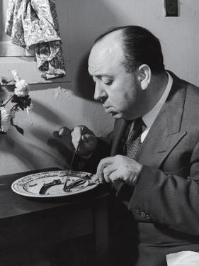 Alfred Hitchcock Eating Lamb Chops by John Florea