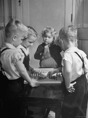 Children Playing Chinese Checkers by John Florea