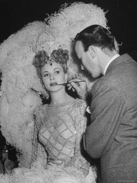 """Chorus Girl Getting Makeup Applied During Production of the Movie """"The Ziegfeld Follies"""" by John Florea"""