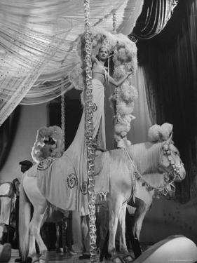 """Chorus Girl Standing on Horse's Back During Filming of the Movie """"The Ziegfeld Follies"""" by John Florea"""