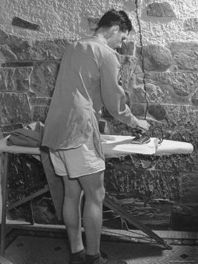 G.I. Ironing His Pants by John Florea