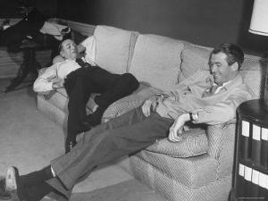 James Stewart Stretched Out on Office Sofa, Smiling, Producer Leland Hayward Slouches at Other End by John Florea
