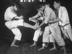 Japanese Karate Student Breaking Boards with Kick by John Florea
