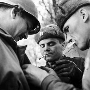 Pair of Russian Soldiers Exchanging Insignia with an American Army Captain by John Florea