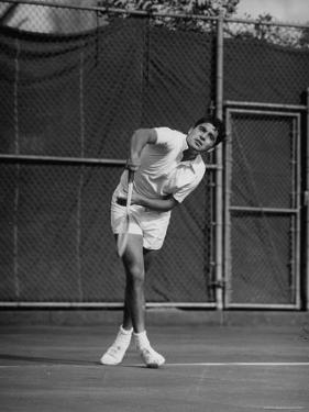 "Richard ""Pancho"" Gonzales Playing in a Tennis Tournament by John Florea"