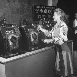 Woman Participating in WWII War Bond Rally in Gambling Casino by John Florea