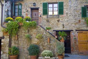 Italy, Tuscany, Courtyard by John Ford
