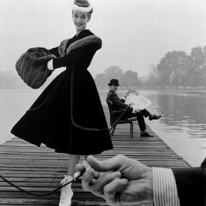 Skater in a Digby Morton Fur Trimmed Velvet Coat and Michael Bentley in the Background, 1955 by John French