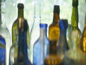 Abstract of Glass Bottles in Window by John Glembin