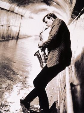 Saxophone Player in Tunnel by John Glembin