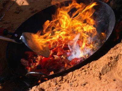 Cooking in Wok Over Camp Fire Simpson Desert, Australia
