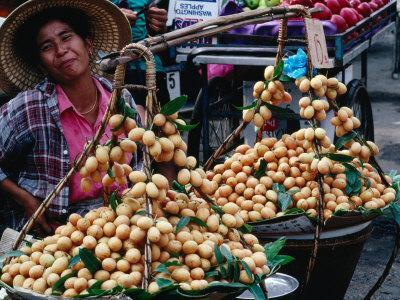 Woman with Food for Sale at Market Bangkok, Thailand