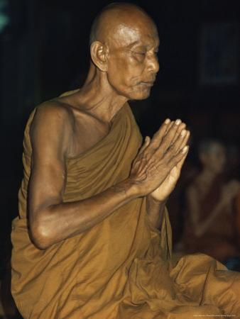 Buddhist Monk Meditating, Wat Suntorn, Bangkok, Thailand, Southeast Asia by John Henry Claude Wilson