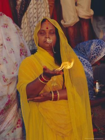 Hindu Woman Pilgrim Holding Fire, Varanasi (Benares), Uttar Pradesh State, India by John Henry Claude Wilson