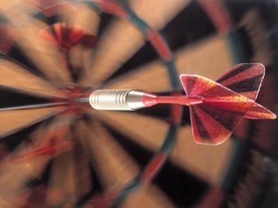 Dart in Bull's Eye on Dart Board