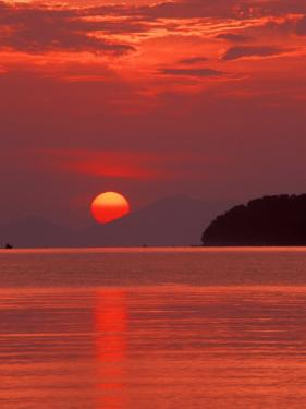 Andaman Sea Glows With Reflected Sunset, Thailand by John & Lisa Merrill