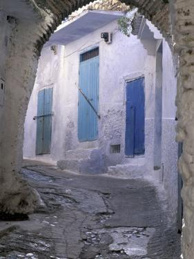 Blue Doors and Whitewashed Wall, Morocco by John & Lisa Merrill