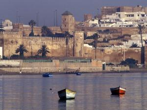 Fishing Boats with 17th century Kasbah des Oudaias, Morocco by John & Lisa Merrill