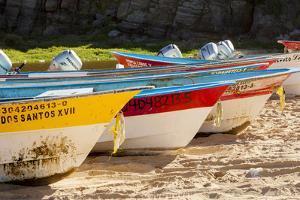 Mexico, Baja California Sur, Todos Santos, Cerritos Beach. Boats pulled up on the beach. by John & Lisa Merrill