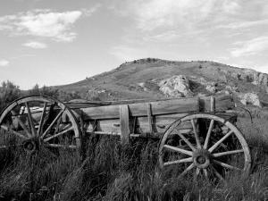 Old Wood Wagon near Mining Ghost Town at Bannack State Park, Montana, USA by John & Lisa Merrill