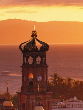 Tower of Nuestra Senora de Guadalupe at Sunset, and Bay of Banderas, Puerto Vallarta, Mexico by John & Lisa Merrill