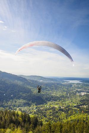 USA, Washington State, Issaquah. Paragliders launch from Tiger Mountain by John & Lisa Merrill