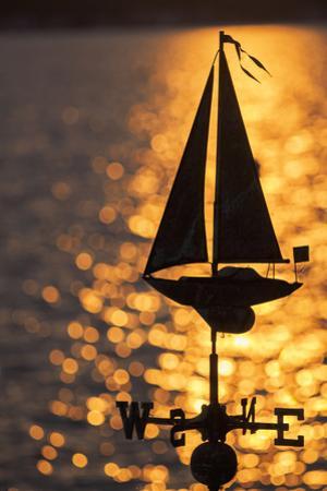 USA, Washington State, Kirkland, sailboat weathervane and sparkling lake by John & Lisa Merrill