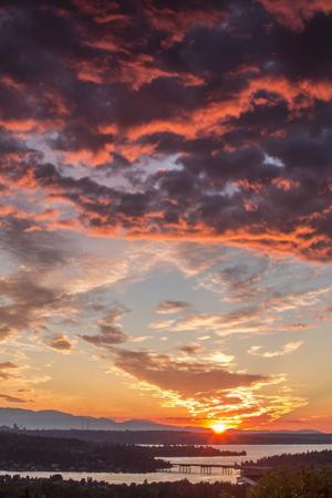 USA, Washington State, Lake Washington, Seattle and Olympic Mountains at sunset. by John & Lisa Merrill