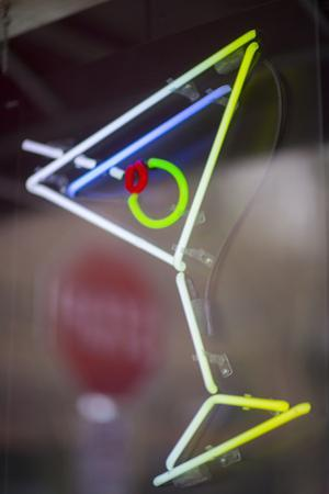 USA, Washington State, Seattle. A neon sign at a bar in the shape of a martini. by John & Lisa Merrill