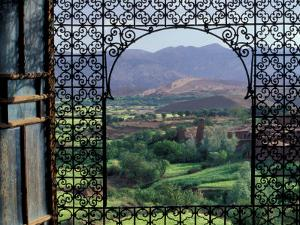 View through Ornate Iron Grille (Moucharabieh), Morocco by John & Lisa Merrill