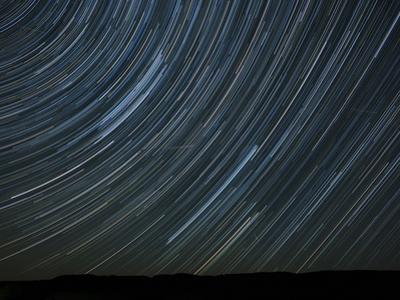 Washington State. Palouse Falls State Park, Star trails and Perseid Meteor Showers by John & Lisa Merrill