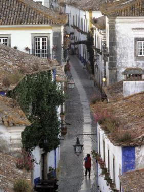 Woman in Narrow Alley with Whitewashed Houses, Obidos, Portugal by John & Lisa Merrill