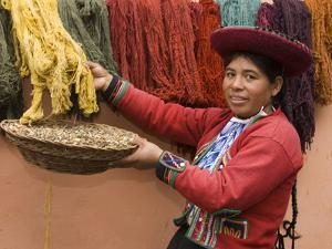 Woman in Traditional Dress, Wool Dyed Before Weaving, Chinchero, Cuzco, Peru by John & Lisa Merrill