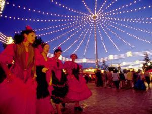 Women in Flamenco Dresses at Feira de Abril, Sevilla, Spain by John & Lisa Merrill