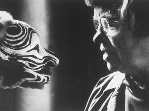 Anthropologist Dr. Margaret Mead Studying a Decorated Tchambul Skull by John Loengard