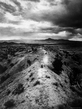 Distant of Artist Georgia O'Keeffe Taking Her Evening Walk at Ghost Ranch by John Loengard