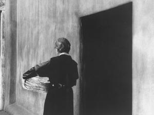 Georgia O'Keeffe Carrying a Basket by John Loengard