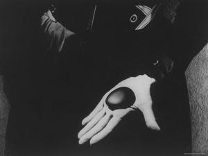 Georgia O'Keeffe Holding One of Her Favorite Stones in Her Palm by John Loengard