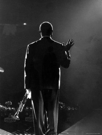 Jazz Trumpeter Louis Armstrong Waving to a Crowd of Adoring Fans as Their Applause Rolls over Him