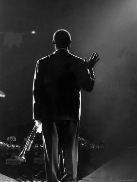 Jazz Trumpeter Louis Armstrong Waving to a Crowd of Adoring Fans as Their Applause Rolls over Him by John Loengard