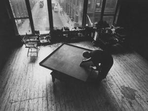 Leader of Minimal Art Movement Ad Reinhardt Working on One of His 'Black' Paintings by John Loengard