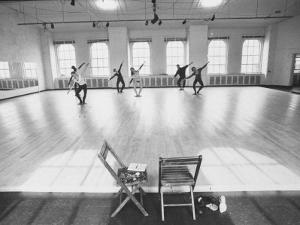 Members of Merce Cunningham Dance Company Practicing before Mirror in Studio by John Loengard