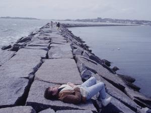 Senator Edward M. Kennedy Basking in Sun on Breakwater in Hyannis Port by John Loengard