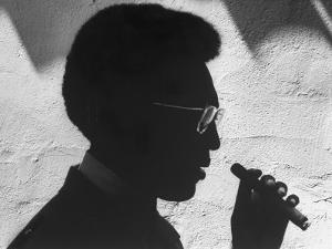 """Silhouette of Actor/Comedian Bill Cosby with Cigar, Former Star of TV Series """"I Spy"""" by John Loengard"""