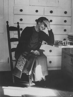 Sister Mildred Barker Consumed with Mirth While Sewing in Sewing Room by John Loengard