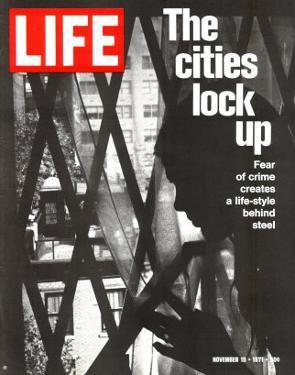 The Cities Lock Up, Woman at Gated Window, November 19, 1971 by John Loengard