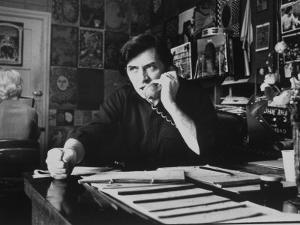 Bill Graham, Owner of Filmores East and West, Talking on Phone as He Works in His Office by John Olson